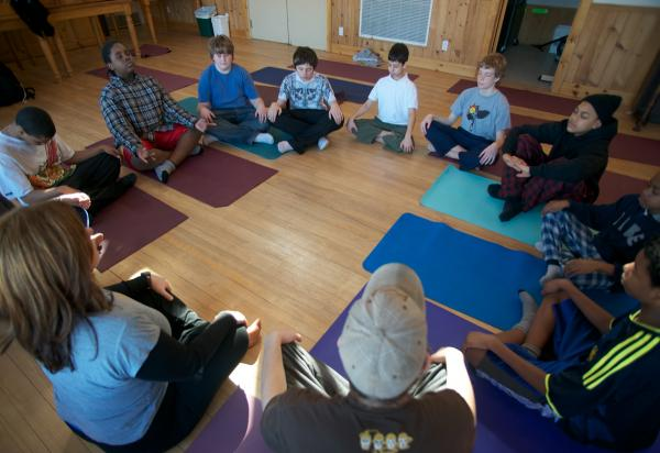 Kids from  Trails Youth Initiatives practice yoga