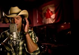 "Dean Brody in studio recording his part for ""Standing Strong and True (For Tomorrow)"""