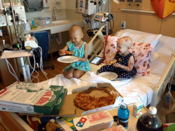 window sign brings piles of pizza to sick child
