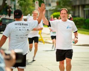 Runners celebrate their achievement at the Father's Day Walk/Run in Halifax