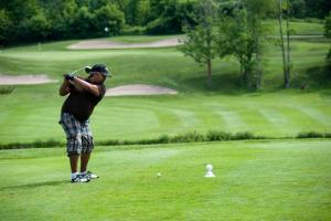 unidentified golfer at 2010's Level Playing golf tournament — photo credit: CWA Photography