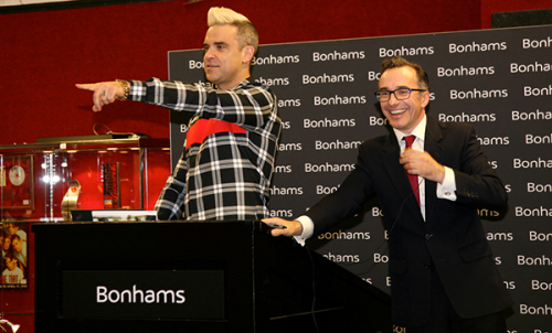 Robbie Williams Helps Ramp Up Charity Auction of 159 ...